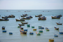The South China sea covered with fishing boats. The fishing harbour of Mui Ne, Vietnam Stock Photography