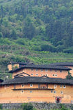 South Chinese traditional residence, Earth Castle among mountains. The Earth Castle of Hakka in Fujian, South of China whcih has over one thousand years history Stock Photos