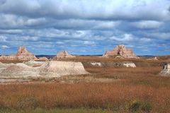 South Dakota Badlands rock outcrops. Surrounded by prairie grasses Stock Photos