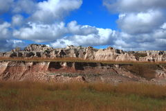 South Dakota Badlands rock pinnacles. With prairie grasses surrounding them Royalty Free Stock Images