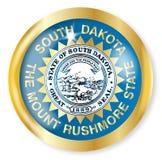 South Dakota Flag Button. South Dakota state flag button with a gold metal circular border over a white background Stock Photo