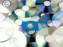 South Dakota flag on top of CD and DVD pile isolated on white. South Dakota flag on top of CD and DVD pile isolated Stock Photos