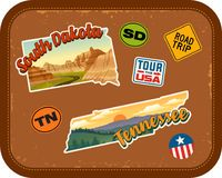 South Dakota, Tennessee travel stickers with scenic attractions. And retro text on vintage suitcase background Stock Photo