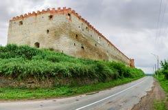 South defense wall of mediaeval Medzhybizh fortress, Khmelnytska Oblast, Ukraine. Ancient stone and brick Medzhybizh fortress of the 14-16th centuries, south and stock photo