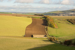 South Downs countryside near Shoreham, England. Fields on the South Downs near Shoreham in West Sussex, England. With tractor ploughing field Royalty Free Stock Photos