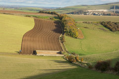 South Downs countryside near Shoreham, England. Fields on the South Downs near Shoreham in West Sussex, England. With tractor ploughing field Stock Photography