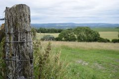 South Downs. A fence post on the South Downs Stock Photo
