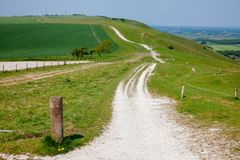 South Downs Way National Trail in Sussex Southern England UK. South Downs Way, a long distance footpath and bridleway along the South Downs hills in Sussex stock photos