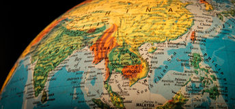 South East Asia Globe. A view of South East Asia on an illuminated globe against a black background royalty free stock image