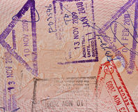 South east asia stamps. In a passport page royalty free stock images
