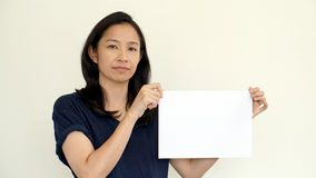 South East Asian girl casually holding while sign for copy space Stock Photo