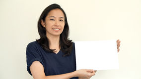 South East Asian girl casually holding while sign for copy space Stock Images