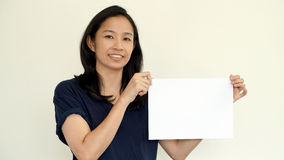 South East Asian girl casually holding while sign for copy space Stock Photos