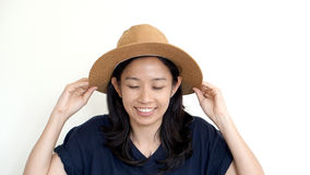 South East Asian girl wearing casual hat, smile and happy on whi Royalty Free Stock Photo