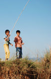 South East Asian kids fishing. Two children fishing in Burma. A rural scene near the capital city, Rangoon, typical of the region Stock Photos