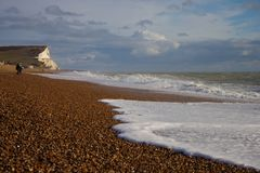 Beach at Seaford - white cliffs in the background royalty free stock photography