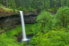 South Falls, Oregon. Strong waterfall in beautiful photogenic setting, with green lush vegetation Stock Image