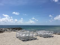 South Florida beach. Chairs showing view of ocean sand Stock Photos