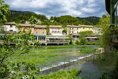 South of France, view on small Provencal town of poet Petrarch Fontaine-de-vaucluse with emerald green waters of Sorgue river. South of France, view on small royalty free stock photo