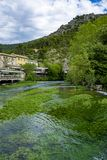 South of France, view on small Provencal town of poet Petrarch Fontaine-de-vaucluse with emerald green waters of Sorgue river. South of France, view on small stock photos