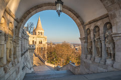 South Gate of Fisherman's Bastion, Budapest, Hungary. South Gate of Fisherman's Bastion in Budapest, Hungary with Statues in Passage at Sunrise stock photos