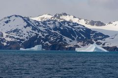Beautiful antarctic landscape with iceberg and mountains stock photo