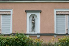 Facades in historical city. In a south german historical city facades with its detailed ornaments and figures describe fascinating romantic view at the time form Royalty Free Stock Photos