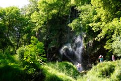 Beautiful waterfall bad urach between trees royalty free stock photography