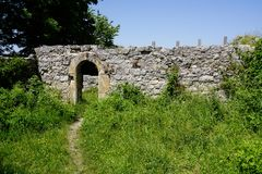 Foot path to gate of castle ruin wall stock images