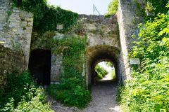 Gate through castle ruin ivy covered wall royalty free stock photo