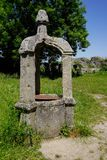 Old medieval fountain in castle ruin royalty free stock photo