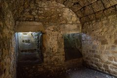 Vaulted cellar of castle ruin low light stock photos