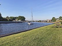 Sailboat on the Black River in South Haven Harbor Royalty Free Stock Images