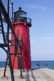 South Haven Pier Lighthouse. A red lighthouse at the end of a pier on Lake Michigan Royalty Free Stock Image