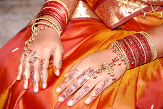 South indian bride's hand. A bride's hand with all sorts of gold jewels Stock Image