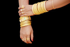 South indian bride's hand. A bride's hand with all sorts of gold jewels Royalty Free Stock Photos