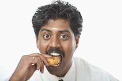 South Indian businessman having vada Royalty Free Stock Photos