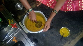 South indian daal preparation by women. Daal preparation in home Royalty Free Stock Images