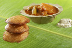 South Indian fast food fried idly with coconut chutney. Royalty Free Stock Photo