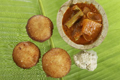 South Indian fast food fried idly with coconut chutney. Stock Photography