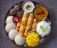 South Indian gluten free vegetarian platter in steel plate royalty free stock photography