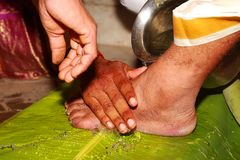 South Indian Hindu Wedding tradition, Groom and Bridal Legs and Hands Ceremonial. South Indian Hindu Wedding tradition Stock Photos