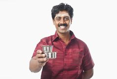 South Indian man holding a glass of tea Stock Images
