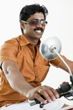 South Indian man riding a motorcycle Stock Images
