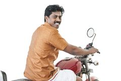 South Indian man riding a motorcycle Royalty Free Stock Images