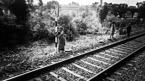 South indian railway women worker. Black and white image , women worker standing near railway line Royalty Free Stock Images
