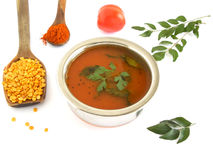 South Indian Soup. Rasam, south Indian soup, is usually eaten by mixing it with hot rice and is prepared from tamarind paste, pigeo peas, chili powder, salt Royalty Free Stock Photography