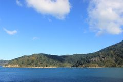 South island of New zealand, cook strait. Islands in the outer parts of the Cook Strait in new zealand, south island, close to picton. View from the ferry. Three Royalty Free Stock Images