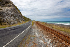 SOUTH ISLAND, NEW ZEALAND - FEBRUARY 12 : Empty road and railway Stock Images