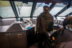 SOUTH ISLAND, NEW ZEALAND- MAY 25, 2017: Close up of a ferry boat with a captain in the command cabin controling the. Ferry, in south island, new zealand Stock Photography